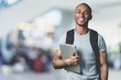 Smiling African Student man with laptop