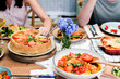 Leinwandbild Motiv Homemade vegetarian dishes on a table