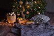 winter decor: Christmas tree,garland,  balls, gifts and cozy striped and gray plaids with pillows