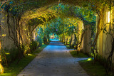 Garden path in resort with warm light and trees on side at evening, Garden Decoration. © Hanoi Photography