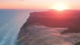 Stunning aerial wide shot of Rubjerg Knude lighthouse at dawn - 232031346