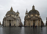 Two medieval churches in Piazza Popolo in Rome in the rain. - 232038540