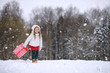 Leinwanddruck Bild - A winter fairy taleA girl on a sled with gifts on the eve of the new year in the park. Two sisters walk in a New Year's park and ride a sled with gifts.