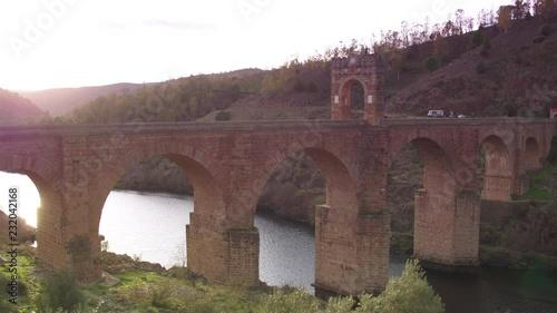 Cinematic tracking shot of Alc√°ntara Bridge