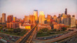 Panoramic perspective of Chicago's West Loop neighborhood during golden hour at Lake Street and Interstate 90. Illinois, USA.