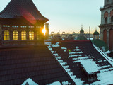 sunset over roof of old european city. winter time - 232047119