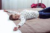 Elegant businesswoman wearing trousers and white blouse lying on bed - 232047365