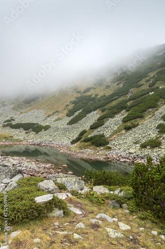 Wall mural Amazing Landscape with fog over Musalenski lakes,  Rila mountain, Bulgaria