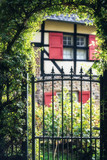 Hedge bow with iron gate in countryside. - 232063116
