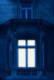 Illuminated window of historical mansion. - 232063160