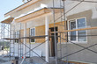 House renovation with plastering and painting walls. Renovate and insulate modern house with insulation and painting.
