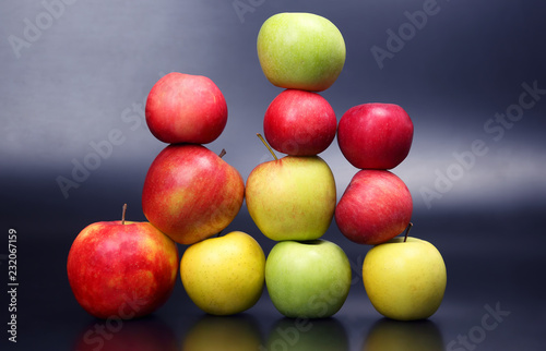 Foto Murales Wall of fresh different apples on dark background