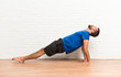 Leinwanddruck Bild - Man doing yoga exercises indoors