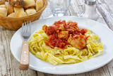 chicken, pasta with tomato sauce