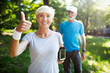 Leinwanddruck Bild - Beautiful sporty mature couple styaing fit with sport