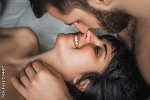 Latin couple making love in the bed