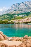 Scenic bench on rocks. Croatia, Makarska, Biokovo, Adriatic Sea.
