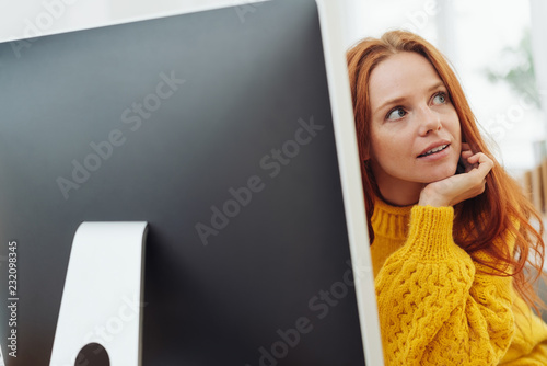 Wall mural Businesswoman listening and watching attentively
