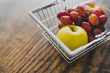shopping basket with healthy fruit in it