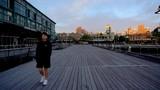 Smooth Shot of an empty wharf as a Man walks along it - 232114940