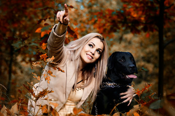 beautiful woman and dog in autumn park