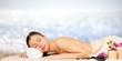 Leinwanddruck Bild - Beautiful young woman relaxing with stone massage at beauty spa