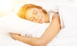 Leinwanddruck Bild - Young woman  sleeping on the white linen in bed at home
