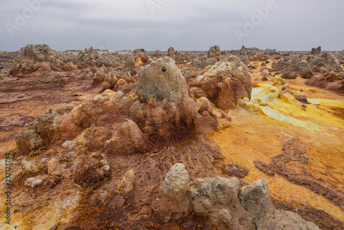 Dallol is an active volcanic crater in the Danakil Trench, Ethiopia. The volcano is known for its extraterrestrial landscapes resembling the surface of Io, the satellite of the planet Jupiter.