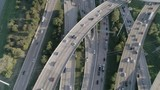 This video is of an aerial of heavy traffic on freeway in major city. This video was filmed in 4k for best image quality. - 232127920