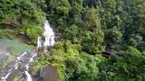 Beautiful waterfall.Tad Khamued Waterfall in southern Laos.It is a place to visit the natural beauty.Mountain forest fall landscape.Top view,Aerial view,waterfall amazing nature background,Rainfores - 232133599