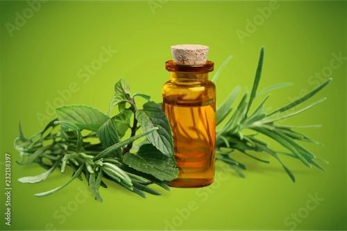 Leinwanddruck Bild Essential Oil with Rosemary Sprig Isolated