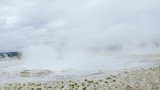 A stablized walk past several steaming geysers and water basins in Yellowstone National Park - 232157519