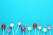 Sweet lollipops on blue background