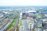 Aerial view of Cologne, Germany. Railway station in the middle, exposition areas on the left, streets and stadium on the right. - 232159395