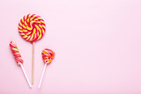 Colorful lollipops on pink background - 232162531