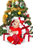 Funny Little baby Santa Claus with Christmas gifts on white - 232175385