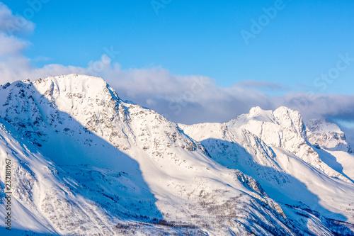 Foto Murales Snowy peaks of mountains