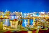 Panorama of Old Venetian Harbour with Lines of Ships and Boats At Blue Hour in Heraklion City in Greece. Blurred Motion of The Boats Due to Wind and Sea Waves On Foreground. - 232193744