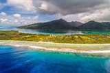 Aerial French Polynesia luxury travel honeymoon destination. Beach vacation at motu island of Huahine, Tahiti, Oceania adventure. View from above of paradise, French Polynesia, South Pacific Ocean. - 232201517