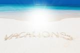 Handwritting inscription word VACATION on sandy beach - 232207100