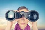 Woman looking through binoculars on white background - 232209311