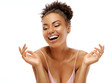Leinwandbild Motiv Young girl with perfect skin. Photo of african american girl laughing on white background. Youth and Beauty