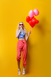 Leinwanddruck Bild - woman and balloons