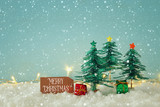 Image of paper christmas trees over white snow. - 232234947