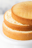 Sponge cake. Shortcakes on a white cake stand, selective focus - 232237780