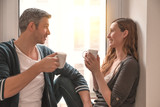 coffee couple sitting on window - 232237906
