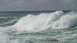 Slow motion shot of large ocean waves coming towards the coast - 232249112