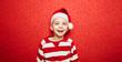 Leinwanddruck Bild - Lachender Junge zu Weihnachten