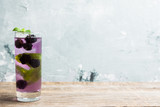 Blackberry mojito cocktail on the wooden background. Selective focus. Shallow depth of field. - 232256159