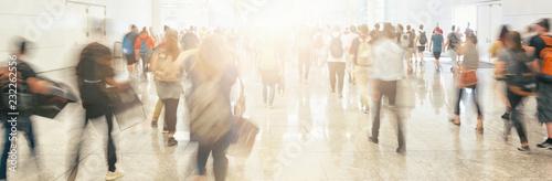 fototapeta na ścianę Crowd of anonymous people walking on trade fair